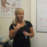 Elizabeth Dutton, foot care trainer, showing how and what to charge